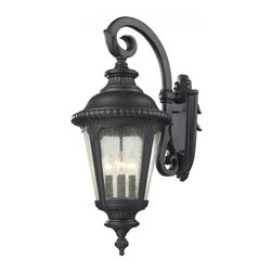 Four Light Black Clear Seedy Glass Wall Lantern - Traditional and timeless, this large outdoor wall mount combines black cast aluminum hardware with seedy glass for a classic look.