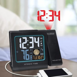 La Crosse - La Crosse Atomic Projection Alarm Clock - Wake up to the time projected onto your wall or ceiling with the La Crosse Atomic Projection Alarm Clock. The easy-to-read information station also features atomic date, moon phase display, snooze function, and a USB charging port.