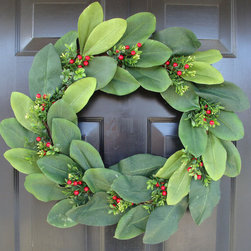 Magnolia Christmas Wreath by Elegant Holidays - This wreath would be beautiful for your front door, or on top of a table, this holiday season.