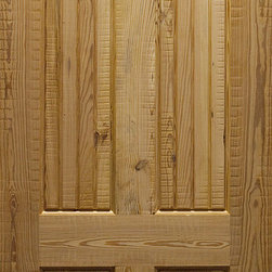 Pine 4-panel Door with Rustic Heartwood Rough-sawn Pine - Here is a very rustic style 4-panel door. This door was made using rough-sawn boards of Pine heartwood to give it an authentic rustic appearance. You can see the rough cut areas and the knots in the wood giving this door lots of character.
