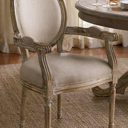 Seating - With more than a nod to elegant Louis XVI design, our oval bergère takes a less formal stance with richly textured upholstery and a substantial hand-carved, vintage-washed oak frame. Endlessly useful, these chairs look equally chic at a writing desk or vanity, in multiples around a dining table or anywhere else you need some occasional.