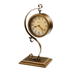 HOWARD MILLER - Howard Miller Jenkins 2-Sided Mantel Clock - Two-sided mantel clock, finished in antique brushed brass, is suspended from a bent metal scroll stand that sits on a cast base.
