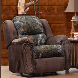 Chelsea Home Furniture Littleton Camo Recliner with Nailheads - Perfect for the cabin, den or even hunting-themed living rooms, this Chelsea Home Furniture Littleton Camo Recliner with Nailheads features a nature-themed brown, mossy green and black upholstery with an attractive nail head trim. The chair offers comfortable and sturdy seating on a high-density foam cushion that contains an innovative sinuous spring system – and it transforms easily into a recliner at the tug of a lever. That makes it a perfect spot to relax swapping stories with friends, watch television, or kick back and enjoy a well-deserved nap after a day spent out in the countryside. The recliner's frame was fashioned from kiln-dried solid hardwood that ensures durability through years of frequent usage and maybe a relocation or five out to the cabin and back. The spacious, oversized seat features whopping measurements of 40 inches wide, 40 inches deep, and 42 inches tall.About Chelsea Home FurnitureProviding home elegance in upholstery products such as recliners, stationary upholstery, leather, and accent furniture including chairs, chaises, and benches is the most important part of Chelsea Home Furniture's operations. Bringing high quality, classic and traditional designs that remain fresh for generations to customers' homes is no burden, but a love for hospitality and home beauty. The majority of Chelsea Home Furniture's products are made in the USA, while all are sought after throughout the industry and will remain a staple in home furnishings.