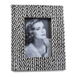 "Concepts Life - Concepts Life Photo Frame  Woven History  5x7"" - Add a touch of glamour with our unique silver Woven History frame. Wrapped in textured silver braids, your photos will instantly appear refined.  Modern home accent Contemporary silver picture frame Beautiful and elegant home accent Rectangular photo frame Made of polyresin Textured finish Easel back for horizontal or vertical display Various sizes available Holds 5 x 7 in. size photo Dimensions: 9""w x 11""h x 1""d Weight: 3 lbs"