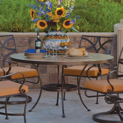 O.W. Lee - O.W. Lee 42 in. Round Patio Dining Table - OWLC345 - Shop for Tables from Hayneedle.com! Every meal will be a Memorial Day picnic when you get to spend time with family and friends around the O.W. Lee 42 in. Round Patio Dining Table. This elegant outdoor table really means business with a top of weather-proof tile and a base crafted from rugged wrought iron. That tough exterior houses a gentle side though as you get to choose the frame finish and tile option that best expresses your personal style. Pull up a chair and get ready to enjoy the outdoors for years to come.Materials and construction: Only the highest quality materials are used in the production of O.W. Lee Company's furniture. Carbon steel galvanized steel and 6061 alloy aluminum is meticulously chosen for superior strength as well as rust and corrosion resistance. All materials are individually measured and precision cut to ensure a smooth and accurate fit. Steel and aluminum pieces are bent into perfect shapes then hand-forged with a hammer and anvil a process unchanged since blacksmiths in the middle ages. For the optimum strength of each piece a full-circumference weld is applied wherever metal components intersect. This type of weld works to eliminate the possibility of moisture making its way into tube interiors or in a crevasse. The full-circumference weld guards against rust and corrosion. Finally all welds are ground and sanded to create a seamless transition from one component to another. Each frame is blasted with tiny steel particles to remove dirt and oil from the manufacturing process which is then followed by a 5-step wash and chemical treatment resulting in the best possible surface for the final finish. A hand-applied zinc-rich epoxy primer is used to create a protective undercoat against oxidation. This prohibits rust from spreading and helps protect the final finish. Finally a durable polyurethane top coating is hand-applied and oven-cured to ensure a long lasting finish. Abo