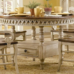 Hooker Furniture - Summerglen Round Dining Table w Storage Base - Touch your home d̩cor with true traditional style. This Summer glen dining table has a spacious round top that easily expands with included 20-inch leaf. The turned legs and lattice apron add interesting lines, while a clever built-in cabinet keeps convenient storage close at hand. Chairs not included. One drawer for storage. One 20 in. leaf. Table extends up to 68 in. L. Hand painted. Casual country dining group. Made from hardwood solids with cherry veneers. 48 in. Diameter x 30 in. H (205 lbs.). Assembly Instructions