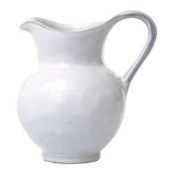 Quotidien Pitcher / Creamer - White Truffle - Greet the day with a morning repast of croissants and a rich roast coffee sweetened with a swirl of pure cream from the Quotidien Pitcher. Pleasing in form and petite in size, the pitcher brings a simple European aesthetic to your tablescape. The lustrous white glaze finish accentuates a subtle artisanal texture that distinctive yet not overly dainty.