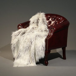 Tibetan Lamb Faux Fur Lap Throw Blanket - I love the realistic look of this faux Tibetan lamb fur throw blanket. The two-toned layers will add beautiful dimension to a sofa. It will be the perfect throw for when warmer days come in like a lamb, but the nights are still harsh like a lion.