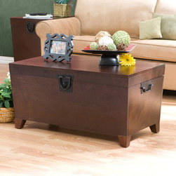 Southern Enterprises - Southern Enterprises Pyramid Trunk Coffee Table - Espresso - CK2224 - Shop for Tables from Hayneedle.com! Have you met the Pyramid Trunk Coffee Table? Let's get acquainted. You can store stuff in it and display stuff on it. After a long day go ahead and prop your feet on it. The flat top makes a perfect spot for a pretty vase of tulips a stack of magazines or a cup of coffee. After all it is a coffee table - an incredibly useful one. When you're not curled up on the couch with your favorite blanket store it inside the deep trunk space. Constructed of MDF wood with pine veneer this coffee table features a beautiful espresso finish. With its good looks and versatility it's a coffee table you'll want to get to know. Assembly required. Tip: You can pair the coffee table with the matching Pyramid Trunk End Table for a complete set. About SEI (Southern Enterprises Inc.)This item is manufactured by Southern Enterprises or SEI. Southern Enterprises is a wholesale furniture accessory company based in Dallas Texas. Founded in 1976 SEI offers innovative designs exceptional customer service and fast shipping from its main Dallas location. It provides quality products ranging from dinettes to home office and more. SEI is constantly evolving processes to ensure that you receive top-quality furniture with easy-to-follow instruction sheets. SEI stands behind its products and service with utmost confidence.