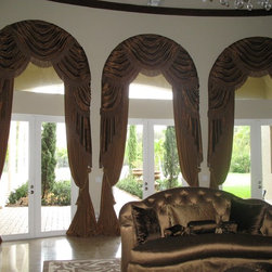 Windows - Arched window w/ swags & jabots. Side panels w/ tassel tiebacks. Bullion trim & two complimentary fabrics & contrast lining.