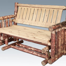"Montana Woodworks - 54 in. Log Handcrafted Glider - Heirloom quality. Skip-peeled by hand using old fashioned draw knives. Made from solid U.S. grown wood. Stained and lacquered finish. Made in USA. Minimal assembly required. 54 in. W x 26 in. D x 34 in. H (98 lbs.). Warranty. Use and Care InstructionsA popular item for the front porch, this glider rocker is enjoyed by many. Finished in the ""Glacier Country"" collection style for a truly unique, one-of-a-kind look reminiscent of the Grand Lodges of the Rockies, circa 1900. First we remove the outer bark while leaving the inner, cambium layer intact for texture and contrast. Then the finish is completed in an eight step, professional spraying process that applies stain and lacquer for a beautiful, long lasting finish."
