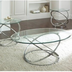 Steve Silver Orion Oval Chrome and Glass Coffee Table Set - Give your living room an instant constellation of style with the ultra sleek Steve Silver Orion Oval Chrome and Glass Coffee Table Set. The brilliantly designed elliptical chrome base is finished in a shiny silver that's sure to reflect your amazing style. A tempered glass top perfectly finishes the look with weightless beauty. Easy-to-clean materials and a mix of texture makes this set as practical as it is beautiful. About Steve Silver Since its founding in Forney Texas in 1987 the Steve Silver Company has had a simple focus: to provide the best quality product at an irresistible price back it up with uncompromising service and continue to improve every day. As one of the premier suppliers of dining sets and occasional furniture in the country Steve Silver is proud to make you the customer its top priority utilizing state-of-the-art equipment proven operating procedures and over 500 000 square feet of facilities. You'll feel equally proud displaying furniture from the Steve Silver Company in your home.