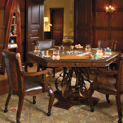 Frontgate - Saratoga Game Table and Four Chairs - Unique, handcarved leather apron. Features a reversible felted top and storage drawers with chip trays. Roomy chairs have thickly padded seats covered in full-grain, aniline-dyed leather. Chairs have a smooth 180° swivel and ball casters for easy movement. Finished with nailhead trim. The ornate, hand-forged wrought iron base gives the Saratoga Game Table a distinctive style advantage, while the handcarved leather tabletop and chair backs add extraordinary character. The hexagonal table comfortably seats six for a night of board games or cards. .  . . Chairs have a smooth 180 degrees swivel and ball casters for easy movement. . Simple assembly.