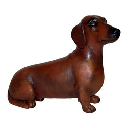 "Ladybug - Hand Painted ""Buster"" Daschund Statue in Red - Hand painted finish. 1-Year warranty. Made in USA. Made of pecan shell resin. 19.50 in. L (8 lbs)The finishes are applied by hand, enhancing every detail, and resulting in the uniqueness of no two pieces being exactly alike. Each individually hand-crafted piece of Ladybug product is cast in a crushed marble or resin composition which has the ability to capture and reproduce the same definition and minute detail as the original. It is a substantial, non-porous material which does not absorb moisture, making it ideal for outdoor use, although it offers the strength and durability required to endure even extreme weather conditions."