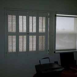 Shutter Solar Roller Shade Colab - Existing Shutter added Solar Roller Shade behind it. Client wanted to keep the shutters, but wanted to reduce glare and heat while still having the shutter louvers open.