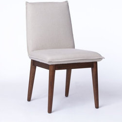 Holly Dining Chair - This almost-pillow-top chair looks comfy. It's perfect for homes that host lots of dinner parties. It has a little midcentury flare in the legs, so simple tables will work best with it.