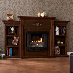 Southern Enterprises - Southern Enterprises Tennyson Espresso Gel Fireplace with Bookcases - FA8545BG - Shop for Fire Places Wood Stoves and Hardware from Hayneedle.com! Just what you need to bring rich beauty to your home the functional Tennyson Espresso Gel Fuel Fireplace w/ Bookcases adds a stately charm to any room. A carved floral design across the top speaks of Old World craftsmanship polished to a rich antiqued espresso finish. Columns spanning down each side of the firebox set off the recessed matching bookshelves. This easy-to-use fireplace requires no special installation. Enjoy the cozy atmosphere in your home or office with no odor or ash. It's energy-efficient too. A single can of gel fuel which crackles like real wood provides 3000 BTUs of heat and the fireplace holds up to three cans at once. It's safe as well: the glass stays cool to the touch. So kick off your shoes and start relaxing in its warm glow.About SEI (Southern Enterprises Inc.)This item is manufactured by Southern Enterprises or SEI. Southern Enterprises is a wholesale furniture accessory company based in Dallas Texas. Founded in 1976 SEI offers innovative designs exceptional customer service and fast shipping from its main Dallas location. It provides quality products ranging from dinettes to home office and more. SEI is constantly evolving processes to ensure that you receive top-quality furniture with easy-to-follow instruction sheets. SEI stands behind its products and service with utmost confidence.