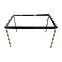 Cassina - Pre-owned Le Cobusier LC10 Rectangular Glass Dining Table - This is a signed and numbered, licensed dining table manufactured by Cassina of Italy. It was originally designed by Le Corbusier, Pierre Jeanneret and Charlotte Perriand in 1928. It has polished chrome-plated steel legs and matte black steel stretchers with 15 mm tempered clear glass top with beveled edge. It was purchased new about 10 years ago, but is still in great shape!