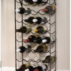 "Oenophilia - Oenophilia Alex 40-Bottle Cellar Wine Rack Multicolor - 010015 - Shop for Wine Bottle Holders and Racks from Hayneedle.com! Everything you need nothing you don't: the Oenophilia Alex 40-Bottle Cellar Wine Rack is an obvious best-seller. Like Alexander himself it's strong reliable and can carry more than you think. Its 40-bottle capacity makes it ideal for the cellar but the black metal frame is too handsome to hide. Includes wall anchors for no-worry security. About OenophiliaWith a name Greek in origin meaning ""the love of wine "" Oenophilia delights in fulfilling its mission to bring together products that allow others to love wine with the passion that Oenophilia does. After creating their first product in 1983 the Oenophilia team has continued to produce and manufacture superior wine accessories and is known as one of the leading wholesale suppliers of wine accessories and gifts in the U.S. Although located in Hillsborough NC traveling the world has allowed Oenophilia to provide customers with a premium extensive collection of wine accessories including openers wine racks glassware and gifts. Oenophilia carries their signature line of original designs and packaging as well as exceptional brands such as Vacu-Vin Metrokane Rogar Srewpull and Spiegelau. Bringing eclectic wine products competitive pricing and responsive customer service to the table is the Oenophilia team's way of sharing their passion while achieving their goal of providing customers with a luxurious one-stop shopping experience."