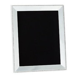 "Beaded Silver-Plated Picture Frame, 8 x 10"" - Gleaming beads edge the polished planes of our silver-plated frames. They make an excellent showcase for black and white photos. Backed with black velvet. Sealed with lacquer to protect the finish. Designed to display vertically or horizontally on a tabletop. Larger frames are sold individually. The mini frames are available as a set of 3 that includes one of each: square, rectangle and round. Monogramming is available at an additional charge. Monogram will be centered above the photo opening. Frame sits vertically when personalized. Watch a video about creating a {{link path='/stylehouse/videos/videos/dt_v4_rel.html?cm_sp=Video_PIP-_-DESIGN_TIPS-_-NEW_FAMILY_WALL' class='popup' width='950' height='300'}}family photo gallery{{/link}}."