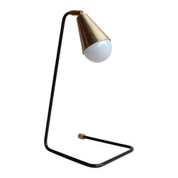 Signature Steel and Brass Desk Lamp - This custom lamp is part steel and part brass. The steel has been darkened and manipulated to form a U curve for the base of the lamp. All brass parts have been polished to create an alluring shine. It has one socket.