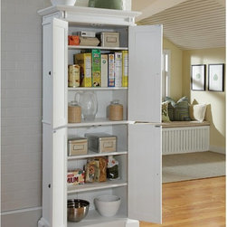 Home Styles - Home Styles Americana White Pantry - 5004-692 - Shop for Pantries from Hayneedle.com! Charmingly traditional the Home Styles Americana White Pantry will brighten any home's decor and provide more than enough storage space for a fully-stocked kitchen. T his versatile cabinet is crafted from sturdy engineered wood and hardwood solids and boasts a breathtaking pastoral design with recessed doors. Both cabinet doors open to fixed and customizable shelving and are coated with the same pristine all-white finish. Measures 30W x 16D x 72H inches; some assembly required.About Home StylesHome Styles is a manufacturer and distributor of RTA (ready to assemble) furniture perfectly suited to today's lifestyles. Blending attractive design with modern functionality their furniture collections span many styles from timeless traditional to cutting-edge contemporary. The great difference between Home Styles and many other RTA furniture manufacturers is that Home Styles pieces feature hardwood construction and quality hardware that stand up to years of use. When shopping for convenient durable items for the home look to Home Styles. You'll appreciate the value.