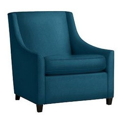 Sweep Upholstered Armchair - I love the pretty shade of blue on this chair. I also like its high back, so it will contrast well with a lower-set couch and tulip-shaped chair. Question: Can you mix fabric, like velvet and leather? I hope so.