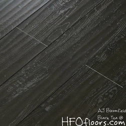 """AJ Bloomfield - Black Tea maple laminate 8.3 mm. hand scraped, embossed, french bleed (black bevel) 5.5"""" wide boards. AC3 rating. Available at HFOfloors.com. *sometimes stocking product."""