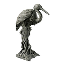 Ladybug - Heron in Reeds Statue (Moss) - Finish: MossWeather resistant finish. 1-Year warranty. Made in USA. Made of pecan shell resin. 10 in. W x 8.50 in. D x 22.50 in. H (13 lbs.)The finishes are applied by hand, enhancing every detail, and resulting in the uniqueness of no two pieces being exactly alike. Each individually hand-crafted piece of Ladybug product is cast in a crushed marble or resin composition which has the ability to capture and reproduce the same definition and minute detail as the original. It is a substantial, non-porous material which does not absorb moisture, making it ideal for outdoor use, although it offers the strength and durability required to endure even extreme weather conditions.