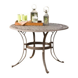 "Home Styles - Home Styles Round Outdoor Dining Table in Rust Brown Finish-48"" Diameter - The Home Styles Round Outdoor Dining Table is constructed of solid cast aluminum with a hand antiqued powder coat rust brown finish. This outdoor dining table features a rounded top with an attractive pattern and an opening at the center to accommodate an umbrella (not included). Add traditional charm to your patio with the Home Styles Round Outdoor Dining Table."