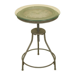 Welcome Home Accents - Inlaid Clock Accent Table - This unique round accent table features an oil rubbed bronze finish and beaded edging. Table top depicts an old world map with roman numeral clock. Removable glass table top. Table has contemporary touches that make it a great option for homes of any decor.  Requires 1 AA battery (not included).  Dust with a dry cloth.  Some assembly required.