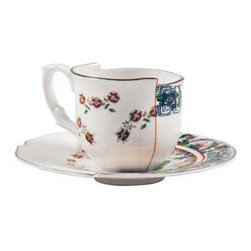 Seletti Hybrid Collection, Tamara Coffee Cup & Saucer, Set of 2 - The Hybrid Tamara set includes two cups and two saucers. Italian to the bone, the set was designed by CtrlZak for Seletti and made of bone china, a material known for its strength, chip resistance, whiteness, and translucency. The floral patterns were refined by hand in blue and orange. Representing Eastern and Western traditions, the designs come together with a orange seam in the middle and differing heights of the cup, embracing contrast and giving tea time a taste of deconstructed, punk style. Stunning, functional, and recommended by Elle Magazine in their December 2012 gift guide, the set is heat- and dishwasher-safe, ready for the table.