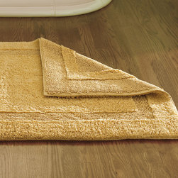 "Frontgate - Reversible Resort Cotton Bath Rug - Features a looped terry side and a sheared terry side. unmatched softness that improves with every washing. Crafted of the finest combed, long-staple cotton. 3000 gsm (grams per square meter) construction makes it extremely plush underfoot. Reversible design allows for twice the wear and half the washings. Crafted from premium long-staple cotton that coordinates perfectly with our Resort Towels, our bath rugs are deliciously plush underfoot. The combed cotton ensures rich, saturated color and exceptional softness.  .  .  .  .  . Machine washable . Approximately 1"" thick. Made in India."