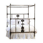 Dunbar Queen Iron Bed, Antiqued Black - A gorgeous statement in the bedroom, this Dunbar iron bed is the perfect fit for your space. Gorgeous cast iron details are found at the center of the head and foot of the iron frame bed and a framed canopy lends drama and height to the gracious bed. Spotlight this bed to perfection with creamy white linens, or use a bright quilt for a more relaxed look.