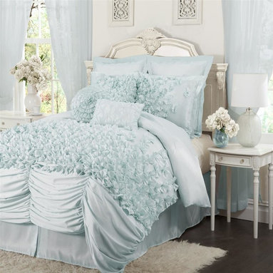 Lush Decor - Lucia 4-pc Blue Comforter Set (Queen) - Choose Size: Queen4-pc set includes: One comforter, one bed skirt, two pillow shams. 250 GSM Comforter. Fabric Content:100% Polyester. Care Instructions: Dry clean. Comforter: 92 in. W x 96 in. DOne of the prettiest and most unique sets in the market this bedding is made from a very soft brushed poly and each of the bowties are made and sewn by hand onto the comforter. The effect of seeing this cascade of bows on this soft fabric is incredible you just want to lie down on the bed and surround yourself with all this beauty.