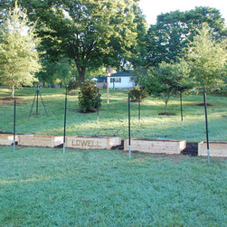 Raised planting beds - Here are some more beds built for a school in our neighborhood. Because of their proximity to a huge park full of deer they got surrounded by a deer fence. Hopefully we will add as many as 7 more identical beds so both the kids at the school and neighboring families can use them.