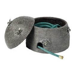 BEEHIVE HOSE HOLDER - Create a buzz with this discreet and whimsical way to hold your garden hose. Features a hole so the hose can easily connect to the spigot, as well as a removable lid for hassle-free plant watering. Made of durable resin and metal, it's a blend of convenience and decorative flair.