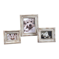 Niho Photo Frames - Set of 3 - They may hold mementos of a sojourn overseas, an unplanned jaunt to the tropics, a golden time passed amidst the shimmery sun and the silvery moon. The Niho Photo Frames are ideally sized for holding a treasured photo or a delicate piece of paper ephemera. The heavily distressed frames boast an aged ivory finish with natural wood undertones. Available as a set of three, the frames hold 4x6, 5x7, and 8x10 photos.