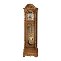 Howard Miller - Howard Miller - Schultz Floor Clock - Embellish your room's decor with this gorgeous anniversary edition grandfather clock defined by olive ash burl corner overlays, lustrous golden oak, an array of select hardwoods and veneers, maneuverable levers and other rich craft details. * This 79th Anniversary Edition floor clock features rare, bookmatched olive ash burl and a raised shell and vine overlay which enhances the graceful bonnet pediment. . Olive ash burl corner overlays frame the crystal-cut oval glass on the lower door, providing a striking view of the pendulum and weights. . The polished-brass dial, specially inscribed through 2005, offers elaborate corner spandrels, a center disk, and a silver chapter ring with applied brass Arabic numerals. An astrological moon phase dial is also featured. . The polished-brass pendulum includes a center disk that complements the dial and coordinates with the banded, polished-brass weight shells. . Elaborately carved, reeded columns with turned top and bottom caps and carved oval appliques enhance the front view of the clock. The multitiered base features a decorative cutout. . Removable beveled glass top side panels allow easy access to the movement. The side lower glass is also beveled. . Cable-driven, triple chime Kieninger movement offers automatic nighttime chime shut-off option. Finished in Golden Oak on select hardwoods and veneers. . Adjustable levelers under each corner provide stability on uneven and carpeted floors. You will receive a free heirloom plate, engraved with name and date, by returning the enclosed request card to Howard Miller. . Locking door for added security. . Automatic nighttime chime shut-off option. . Manufacturer's 2 Year Warranty. *84-1/4in (214 cm) H x 23in (58 cm) W x 13-1/2in (34 cm) D