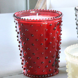 Reindeer Hobnail Glass Candle - Enclosed in a vintage-style textured glass cup that looks especially charming in the kitchen or bath, the Reindeer Hobnail Glass Candle is scented with an autumnal air of fir needles and cedar logs made warmer by red winter berries.  Versatile and long-burning, the vegetable wax candle makes a delightful hostess gift at the start of the season and a flickering companion all through it.