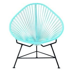 Acapulco Chair - This nearly neon Acapulco chair screams summer. I would bring it inside just in time for winter so that I could pretend it's summer by the fire.