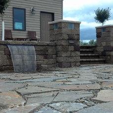 Traditional Patio by Cutting Edge Yard Art