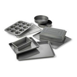 Calphalon Nonstick Bakeware 10-Piece Set - Even those stickiest, trickiest, gooiest desserts are no match for the Calphalon Nonstick Bakeware 10-Piece Set, which features interlocking nonstick layers for high release. You'll get it all with this set, including a 12-cup muffin pan, a 12 x 17-inch baking sheet, a medium loaf pan, two 9-inch round cake pans, a 14 x 17-inch cookie sheet, a 9 x 13-inch brownie pan, a 9 x 13-inch covered cake pan, and a cooling rack. The heavy-gauge steel cores help create even heating across the surface, and all pieces are dishwasher safe. Includes manufacturer's full lifetime warranty.About CalphalonCalphalon's mission is to be the culinary authority in kitchenwares, enhancing the home chef's food experience during planning, prep, cooking, baking, and serving. Based in Toledo, Ohio, Calphalon is a leading manufacturer of professional quality cookware, cutlery, bakeware, and kitchen accessories for the home chef. Calphalon is a Newell-Rubbermaid company.Calphalon's goal is to give you, the home chef, all the tools you need to realize your highest potential in the kitchen. From your holiday roasting pan to your everyday fry pan, count on Calphalon to be your culinary partner - day in and day out, for breakfast, lunch, and dinner for a lifetime.