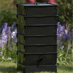 """The Worm Factory - The Worm Factory 5-Tray Recycled Plastic Worm Composter - Black - 5-TRAY BLACK - Shop for Garden Equipment from Hayneedle.com! The Worm Factory 5-Tray Recycled Plastic Worm Composter - Black is like a capsule hotel in Tokyo except the guests are 6 000 worms and it goes in your backyard. Made from 100% recycled plastic this composter allows worms to happily nosh 24/7 on your kitchen waste and whatnot providing you rich organic material. Odorless well-organized green and best of all the worms will eat the kitchen waste you leave behind. Even your junk mail! What is The Worm Factory and how does it work?Unique and ingenious the Worm Factory is a composter comprised of stacking trays in which worms eat your scraps and leave behind rich organic material. Fill each tray with scraps like vegetables fruits egg shells coffee grounds paper and junk mail and in turn you'll get nutrient-rich compost for your garden. Worm castings are known to be the very best compost available. Your plants will thrive with this all-natural compost. Worms start in the bottom tray and work upward as they break down the waste. The worms leave behind the stuff and you don't even have to sort through the wiggly friends at all as they're already on the next tray up. Plus nutrient-rich moisture is captured in the collection tray and can be used as liquid fertilizer known as """"worm tea."""" What are the benefits of using The Worm Factory? It's Compact: It stacks instead of spreading out so if you're short on space no worries. The Worm Factory takes up a minimal amount of space. Odorless: With a smart ventilation lid and specific suggestions in the instruction manual The Worm Factory remains odorless as it works tirelessly to create rich organic material. So breathe easy! Easy to Manage: The trays are lightweight and easy to stack and move and the accompanying instruction manual is chock full of suggestions to make composting easy and seamless. Saves Time: Forget running out to your compo"""