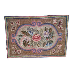 Used Vintage Hooked Rug - Hooked rugs have roots in American textile folk art. This rectangular throw rug has a floral pattern with scroll designs and looks like it was made circa 1900. It is handmade by hooking strips of fabric into burlap backing, most likely a burlap feed sack. Many women sat by the fireside during cold New England nights and made hooked rugs, darned socks or quilted.   This rug has signs of it's age but it was made to last and it has many good years left.