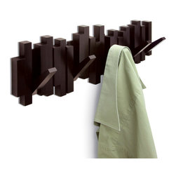 Contemporary Brown Plastic Coat Rack - Blending sculptural wall decor with common functionality, this sleek coat rack offers five sturdy hooks that flip up when not in use. Highlighted by a rich espresso finish, the moveable design allows it to become contemporary wall decor when not in use.
