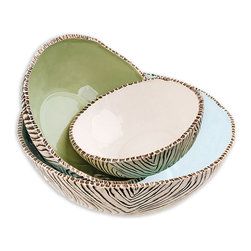 Set of 3 Ceramic Stacking Bowls - Birch - Ranging in size from salad server to cereal bowl, the Birch Stacking Bowls with their mix of sophisticated cream and chic, cool melon green interiors truly offer tabletop splendor in a mode that can transfer from rustic and restrained to playfully whimsical at the simple switch of an accessory. Gorgeously-textured bark-like outer surfaces add the artful organic impression to this beautiful nesting trio.