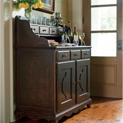 Paula Deen Down Home Low Sideboard with Hutch - Tobacco - Any well-appointed Southern home has a fully stocked bar and the Paula Deen Down Home Low Sideboard with Hutch - Tobacco is the perfect way to keep yours tidy and always at the ready. This beauty is crafted of solid hardwoods in a dark tobacco finish that brings out each curved detail. The sideboard features three drawers, a smart power outlet, and two cupboard doors that open to reveal a wine rack and plenty of open space. The hutch on top includes four right-sized drawers and a top shelf for display. Now all you need is mint, simple syrup, and bourbon and you've got a soiree.About Universal Furniture InternationalRecognized as a leader in exceptionally crafted home furnishings, including bedroom and dining room items, entertainment centers, and more, Universal strives to make items that are styled to endure but always remain fresh. They make it a goal to include features that fit the way their customers live today, and to find prices that put high-quality products within reach. These are the principles that guide the work at Universal, essential elements of good, affordable, and smart design.