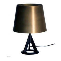 """Tom Dixon - Tom Dixon Base Table Lamp - The Base Table Lamp is designed by Tom Dixon and made by Tom Dixon. With its industrial aesthetic cast iron base, minimal metallic shade and classical proportions, Base remains an interior design staple   so popular, that we've added a highly-polished copper shade to the range.  Conventional matt textured cast iron makes up Base Light's robust body with a spun-copper shade - highly polished to create a super-reflective and alluring shine.With its industrial aesthetic cast iron base, minimal metallic shade and classical proportions, the Base Table Lamp is an interior design staple. The base of the light uses the technique of sand casting, a process which involves compacting sand into a casting box and pouring in liquid iron to form the shape. Available with a brass or copper shade. Ships with 118"""" of black fabric cable with an inline switch.      Product Details:  The Base Table Lamp is designed by Tom Dixon and made by Tom Dixon. With its industrial aesthetic cast iron base, minimal metallic shade and classical proportions, Base remains an interior design staple   so popular, that we've added a highly-polished copper shade to the range.  Conventional matt textured cast iron makes up Base Light's robust body with a spun-copper shade - highly polished to create a super-reflective and alluring shine.With its industrial aesthetic cast iron base, minimal metallic shade and classical proportions, the Base Table Lamp is an interior design staple. The base of the light uses the technique of sand casting, a process which involves compacting sand into a casting box and pouring in liquid iron to form the shape. Available with a brass or copper shade. Ships with 118"""" of black fabric cable with an inline switch.  Details:     Manufacturer: Tom Dixon   Designer: Tom Dixon   Made in: United Kingdom   Dimensions: Base Diameter: 5.9"""" (15 cm) x Height:15.5"""" (39 cm) x Shade Diameter:10.6"""" (27 cm)   Light bulb: 1 x  G16.5 Max 25W clear globe Inca"""