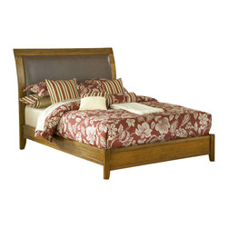 Modus Furniture - Modus City II Upholstered Low Profile Sleigh Bed in Pecan - Queen - The City II collection delivers the same modern chic styling as its older sibling but at a more affordable price. The group is constructed with tropical hardwoods and veneers finished in a deep Coco tone and features a padded faux leather headboard. City II is manufactured with all the same construction features that are expected of a Modus Furniture product, including sanded and stained Solid wood drawer boxes with English dovetail front and back, Full extension ball bearing drawer glides, felt lined top drawers on select pieces, and discrete metal-to-metal bed rail fittings for easy assembly and long term durability.